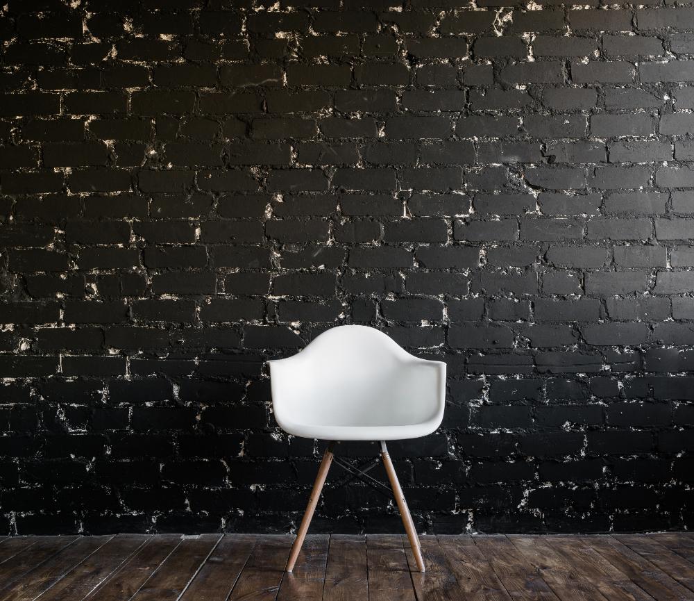 chair against black brick background